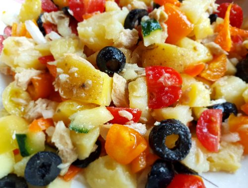 Country potato salad with tomato, red pepper, olives